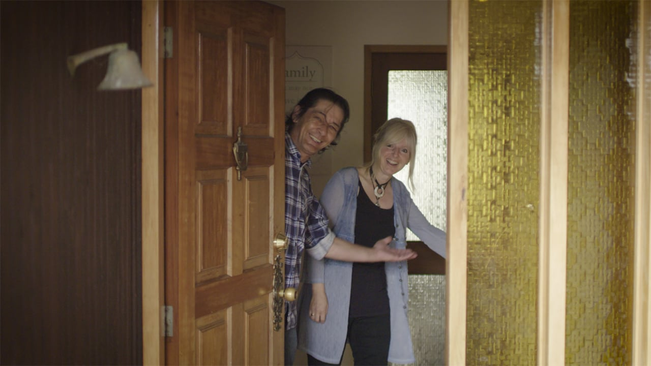 Dave and Tina opening the front door